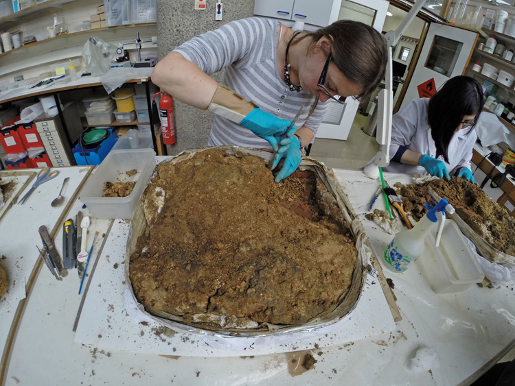 MOLA's archaeological conservators micro-excavate sections of the 1st century fresco in the lab © MOLA