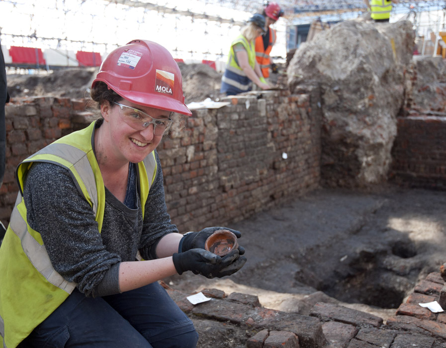 MOLA archaeologist Sarah Trehy excavating the exceptionally well preserved remains of Shakespeare's Curtain theatre in Shoreditch (c) MOLA