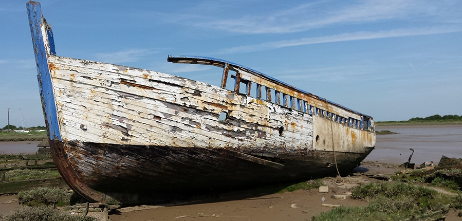 An abandoned vessel at Maldon's 'barge graveyard' ...