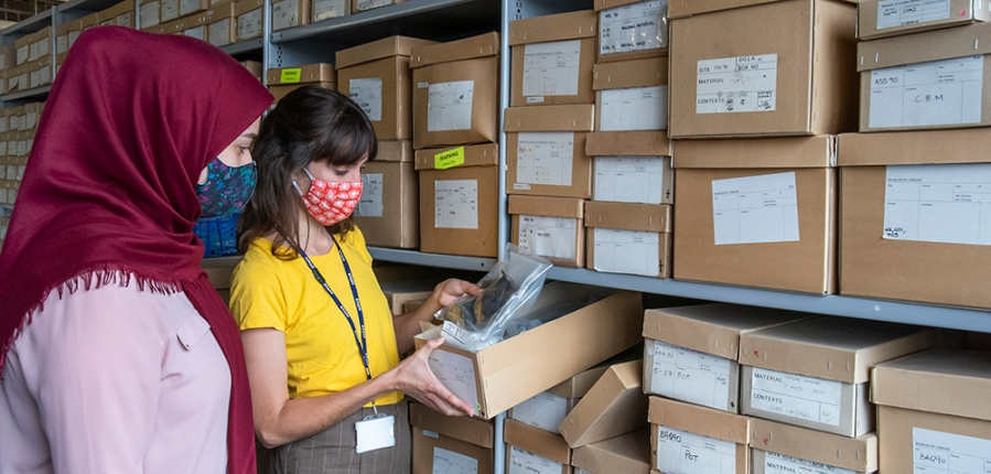 Archivists at MOLA look through boxes of archaeological material (c) MOLA
