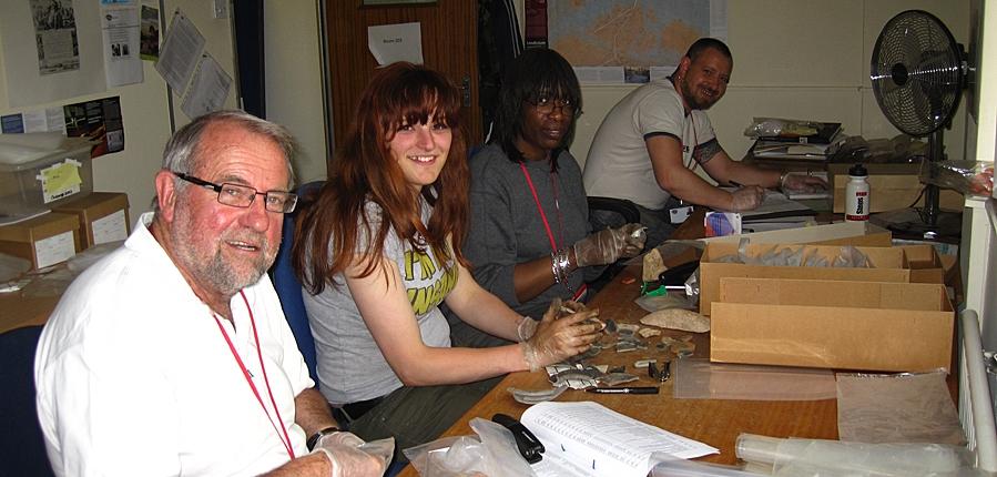 Volunteers working on animal bone