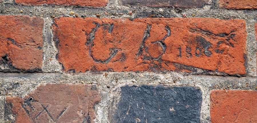 Historic graffitti on brick wall