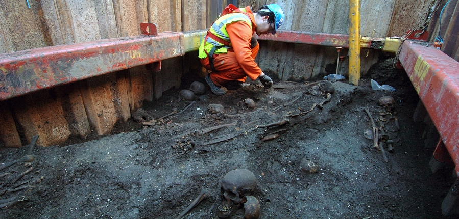 MOLA archaeologist excavating burials at Crossrail Liverpool St site