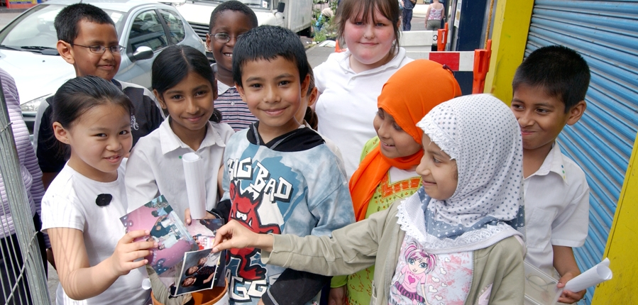 local children place items into a time capsule