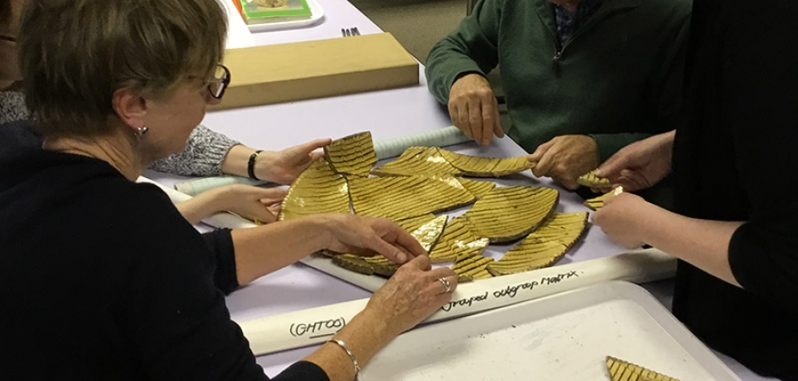 MAAST participants piece together sherds of pottery (c) MOLA