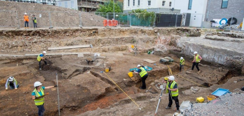 An overview of a large section of the excavation site, with archaeologists engaged in various activities