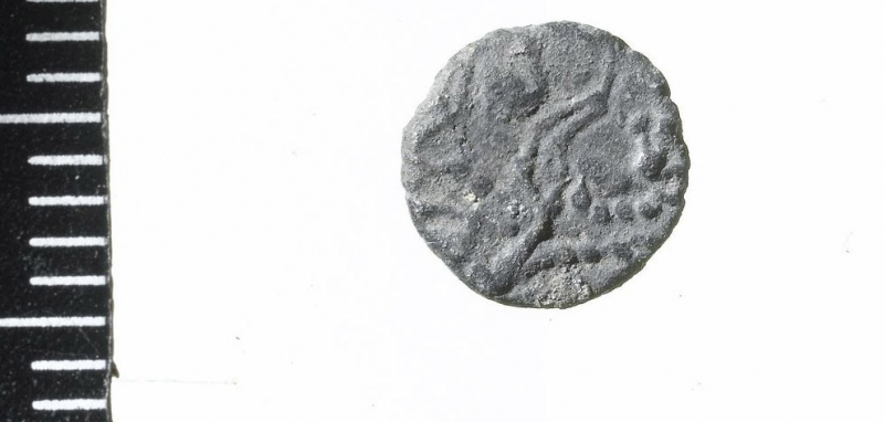 A crude 'Barbarous Radiate' copy of a coin of the Emperor Victorinus, AD 275-85. (c) MOLA