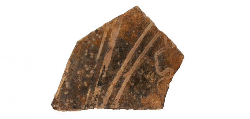 Fragment of medieval glass found during excavations at Drapers' Hall in Coventry (c) MOLA