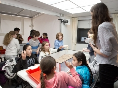 School children exploring archaeology on the MOLA Time Truck (c)MOLA