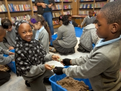 School children learning about archaeology