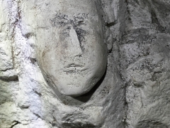 A face carved into the soft chalk of the Fan Bay deep shelter near Dover, Kent.