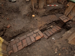 Remains of the inner wall of the Curtain Theatre yard uncovered in Shoreditch