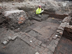 Archaeologist records the remains at the Curtain Theatre (c) MOLA