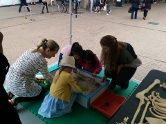 Children and adults have a go at excavating on board the Time Truck (c) MOLA