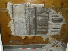 The exposed area of painting on the north wall of the cupboard