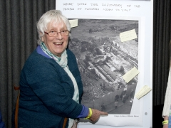 Marian Mason with her image from the Temple of Mithras archaeology excavations