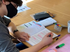 Trainee Archaeologist using MOLA's workbook during a classroom session