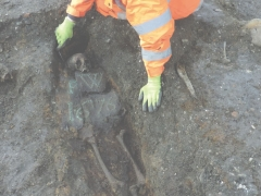 Excavation of a burial with studded coffin (c) Crossrail