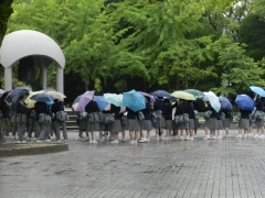 Group of school-children next to the Peace Bell in Hiroshima Peace Memorial Park (c) MOLA