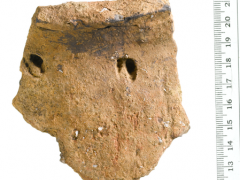 Large round-shouldered, round-bottomed vessel with deep impressions widely spaced below the rim - the latter possibly created using the hoof of a dead roe deer faun. Residues found within suggest it was used to process meat stew.