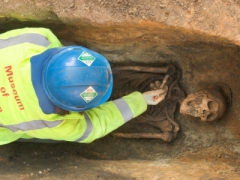 Excavating a burial.