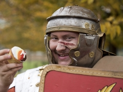 Roman re-enactor and archaeology trainee Matthew with a MOLA cupcake