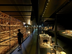 The Mary Rose hull and Context Gallery where artefacts are displayed on a mirrored.