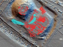 The combined results of all three surveys, showing wall foundations and discrete cut earth features (solid red), rubble or yard surfaces (hatched red), and the moat (blue) (c) MOLA