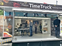 Young people display their work on local archaeology on board the Time Truck