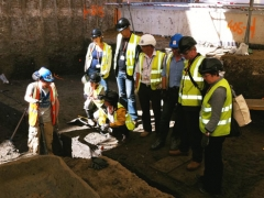 MOLA geoarchaeologist Virgil Yendell explains to visitors from MOLA, Skanska, English Heritage and City of London how the city ditch was formed and later silted up