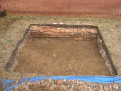 The base of an 18th-century wall revealed just below the turf