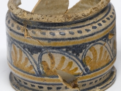 Polychrome and blue and white decoration using simple geometric motifs on tin-glazed ware ceramic from a MOLA excavations at Wood Street