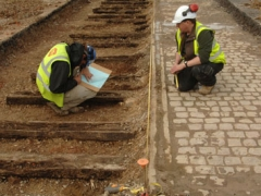 Archaeologists recording railway sleepers from the low-level railway in the area of the Milk and Fish Shed