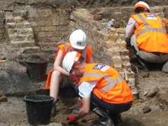 Members of the local community take part in an excavation in Stepney Green, hosted by Crossrail
