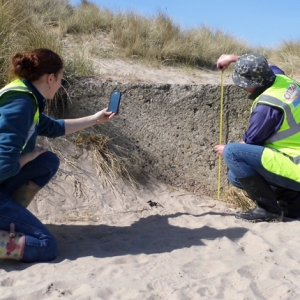 CITiZAN archaeologists recording a World War II tank trap on the Northumberland coast