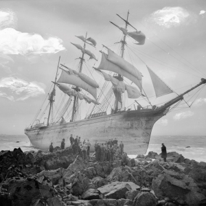 A starboard bow view of the three-masted barque Glenbervie (1866) with crowds of people, on the rocks at Lowland Point. G14146. © National Maritime Museum, Greenwich, London, Gibson's of Scilly Shipwreck Collect