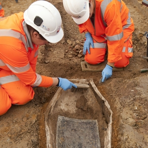 Archaeologists clean the coffin plate of Lucy Lawrence (c) HS2 courtesy of MOLA Headland