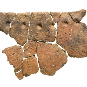 Multiple fragments of a large Early Neolithic bag-shaped round-bottomed vessel with finger impressions spaced below the rim. Residues found within suggest it was used to process meat stew © MOLA.jpg