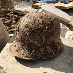A World War One German helmet found at Park Crescent West, London (c) MOLA