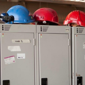 Archaeologists' hard hats on top of lockers (c) MOLA