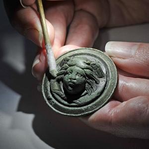 Medusa pendant under conservation