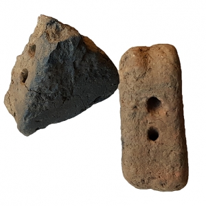 Triangular Iron Age fired clay loom weights (c) Highways England courtesy of MOLA Headland Infrastructure