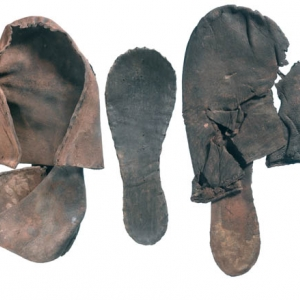 A collection of leather shoes discovered by MOLA at the Crossrail site near Charterhouse (c) Crossrail