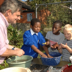 Local school children wash archaeological objects