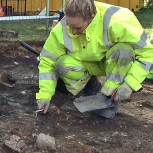 Trainee archaeologists Dunia, Janita and Abigail excavate Allen Gardens