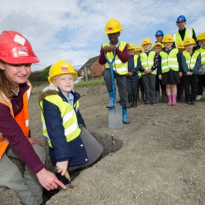 Susan Porter from MOLA pictured with children from St Blaise CoE School (c) Redrow
