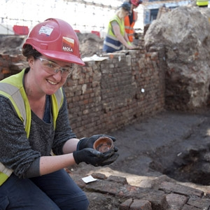 MOLA archaeologist Sarah Trehy at Curtain theatre (c) MOLA