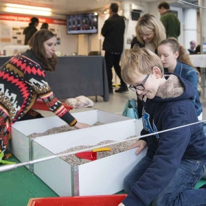 Children have a go at excavation on board the Time Truck (c) MOLA