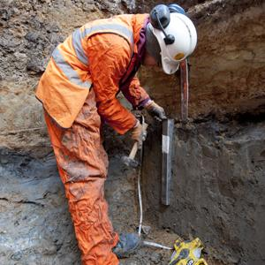 Geoarchaeologist conducting a borehole survey