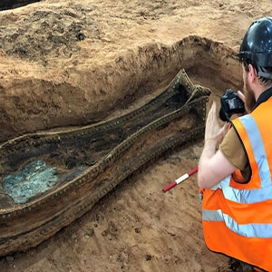 archaeologist recording coffin on dig HS2 Park Street Excavation